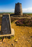 Trig point with derelict windmill, Parys Mountain. Stock Image