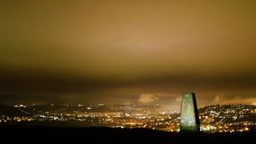 Trig point on Little Solsbury Hill overlooking Bath. Timelapse of the UNESCO World Heritage City of Bath at night, with stone used for cartographic triangulation stock video