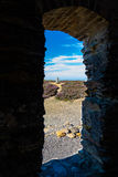 Trig point seen through arch, Parys Mountain. Royalty Free Stock Photography