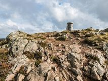 Trig Point, Summit of Eildon Hill, Scotland. Hillwalker`s view of the trig point on the rocky summit of Eildon Hill, Borders Region, Scotland Stock Photos