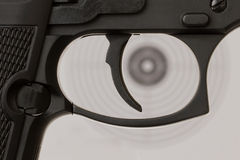 The trigger of a handgun with a shooting target Royalty Free Stock Photo
