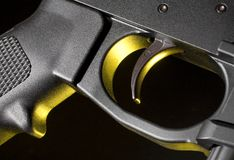 Trigger and pistol grip in yellow Stock Images