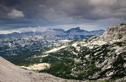 Triglav Lakes Valley and Krn peak with rain clouds, Julian Alps. Limestone landscape of Seven Triglav Lakes Valley with Krn peak under storm clouds, from Stock Photography