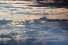 Triglav peak above sunlit sea of clouds, Julian Alps, Slovenia stock image