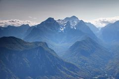Triglav peak with forested Vrata and Kot Valley in Julian Alps Stock Photo
