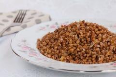 Trigo mourisco com cebola fritada Fotografia de Stock Royalty Free