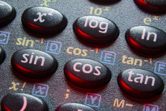 Trigonometry buttons. Trigonometry functions push buttons of scientific calculator; focus on cos button Stock Images