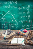 Trigonometry classes in school. On old wooden table Royalty Free Stock Photos