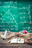 Trigonometry classes in school. On old wooden table Royalty Free Stock Images