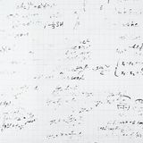 Trigonometry math equations and formulas. Squared sheet of paper filled with partially erased trigonometry math equations and formulas as a background Stock Image