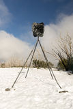 Trigonometry Point. A trigonometry point marker on the summit of a mountain covered in snow Stock Photos