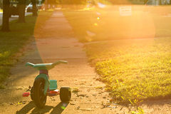 Trike. An abandoned tricycle at sunset Royalty Free Stock Photo