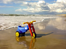 Trike. Children´s trike on the beach Stock Image