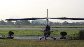The trike goes on the runway. The aircraft is passing through the gate and taxiing to the runway stock video footage