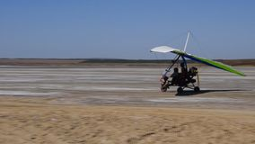 Trike on the salt lake. Preparing for flight stock footage