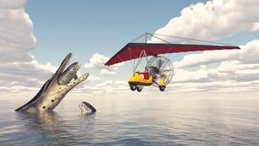 Trike ultraligero sobre el mar y el reptil marino prehistórico Fotos de archivo