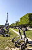 Trikke Vehicles in Paris. Paris,France-May 13, 2012: Modern electric Trikke vehicles parked on Champ de Mars in front of the Eiffel Tower in Paris in a beautiful Stock Image