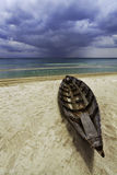 Trikora Beach. Old canoe on the beach in Indonesia Stock Images