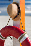 Trilby and lifebuoy. At the summer beach Royalty Free Stock Image