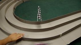 Trilha de corridas de carros do brinquedo video estoque