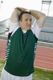 Trilha de Stretching On Race do atleta imagem de stock royalty free