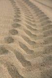 Trilha do pneu na areia. Fotografia de Stock