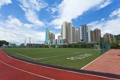 Trilha e estádio Running na área residencial Imagem de Stock