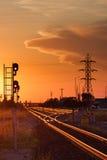 Trilha e linhas elétricas no por do sol Imagens de Stock Royalty Free
