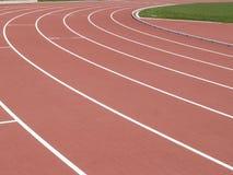 Trilha sintética do atletismo - vermelho imagem de stock royalty free