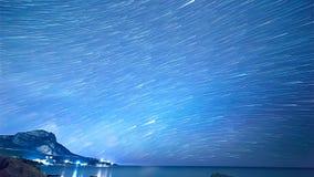 Trilhas da estrela sobre o mar Lapso de tempo imagens de stock royalty free