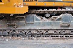 Trilhas da máquina escavadora. Fotografia de Stock