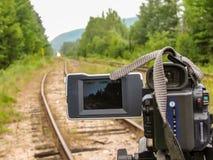 Trilhas de observação do trem da câmara de vídeo Imagens de Stock Royalty Free