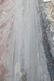 Trilhas enlameadas da estrada de terra e do pneu Foto de Stock Royalty Free