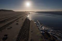 Trilhas na praia Imagens de Stock