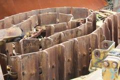 Trilhas oxidadas da escavadora Imagem de Stock Royalty Free