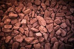 trilhas Railway da rocha vermelha, filtro de pedra do vintage do fundo Imagem de Stock Royalty Free