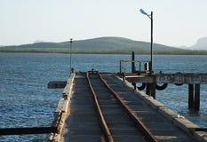 Trilho do trem na água Fotos de Stock Royalty Free