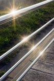 Trilhos com reflexões da luz do sol Fotografia de Stock