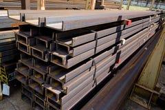 Trilhos de aço inoxidável depositados nas pilhas Imagem de Stock Royalty Free