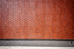 Trillende bruine bakstenen muur Royalty-vrije Stock Foto's