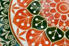 Trillende oranje en donkergroene kleur van een geschilderde bovenkant van de steenlijst, voor achtergrond Stock Foto