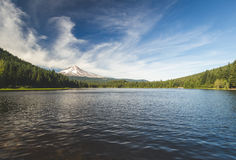 Trillium Lake Mount Hood Oregon. Beautiful, serenity, serenely, serene, pretty, gorgeous, blue, green, trees, water, body of, clouds, sky, tree line, nature Stock Photo