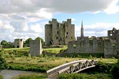 Trim Castle. Wooden footbridge, wall ruins and Trim Castle Stock Photo