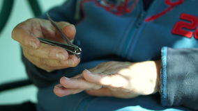 Trim Fingernails With a Nail Clipper. Cipping fingernails on camera.Nail clippers are usually made of stainless steel but can also be made of plastic and stock video footage