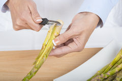 Trim and peel asparagus Stock Photo