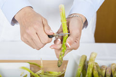 Trim and peel asparagus Royalty Free Stock Photo