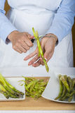 Trim and peel asparagus Stock Images
