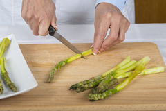 Trim and peel asparagus Stock Image