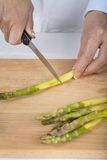 Trim and peel asparagus Royalty Free Stock Photos