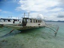 Trimaran at paradise tropical island beach, Coron, Philippines Royalty Free Stock Image